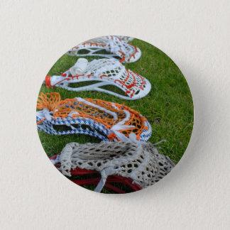 Lacrosse sticks button