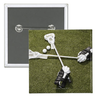 Lacrosse sticks, gloves and balls on artificial pins