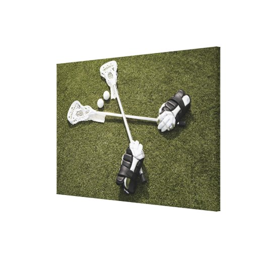 Lacrosse sticks, gloves and balls on artificial canvas print