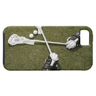 Lacrosse sticks, gloves and balls on artificial iPhone 5 case