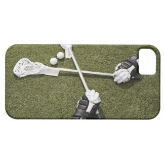 Lacrosse sticks, gloves and balls on artificial iPhone 5 cover