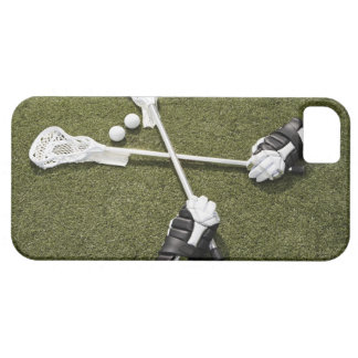 Lacrosse sticks, gloves and balls on artificial iPhone 5 covers