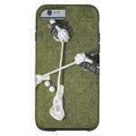 Lacrosse sticks, gloves and balls on artificial tough iPhone 6 case