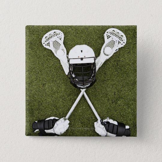 Lacrosse sticks, gloves, balls and sports helmet button