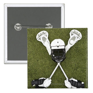 Lacrosse sticks, gloves, balls and sports helmet buttons