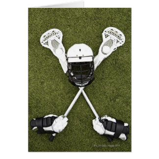 Lacrosse sticks, gloves, balls and sports helmet card