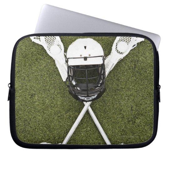 Lacrosse sticks, gloves, balls and sports helmet computer sleeve