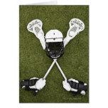 Lacrosse sticks, gloves, balls and sports helmet greeting card