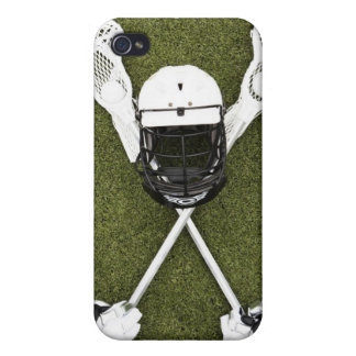Lacrosse sticks, gloves, balls and sports helmet iPhone 4/4S cover