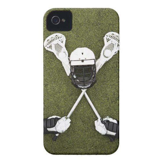 Lacrosse sticks, gloves, balls and sports helmet iPhone 4 cover