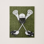 "Lacrosse sticks, gloves, balls and sports helmet jigsaw puzzle<br><div class=""desc"">AssetID: 200443159-001 / {Thomas Northcut} / Lacrosse sticks,  gloves,  balls and sports helmet on artificial turf</div>"