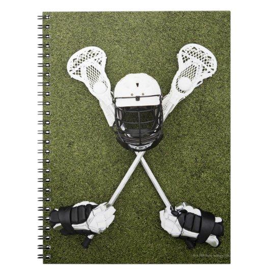 Lacrosse sticks, gloves, balls and sports helmet notebook