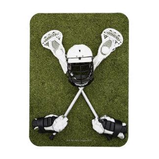 Lacrosse sticks, gloves, balls and sports helmet rectangular magnet