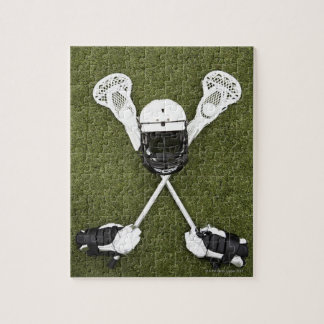 Lacrosse sticks, gloves, balls and sports helmet puzzle