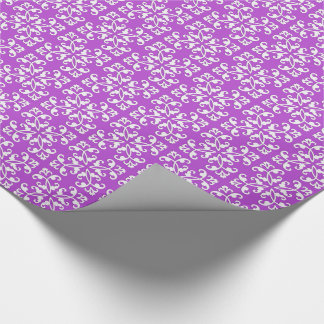 Lacy cutwork - white over amythyst purple wrapping paper