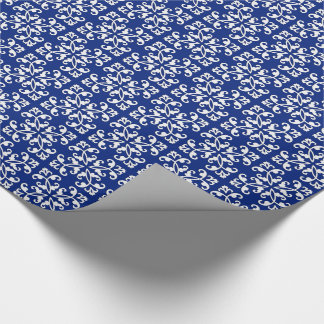 Lacy cutwork - white over lapis blue wrapping paper