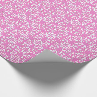 Lacy cutwork - white over orchid pink wrapping paper