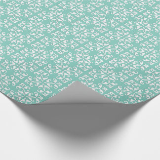 Lacy cutwork - white over seafoam green wrapping paper