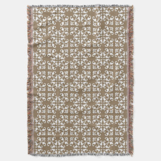 Lacy cutwork - white over taupe tan throw