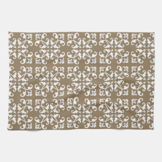 Lacy cutwork - white over taupe tan towel