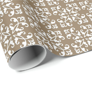 Lacy cutwork - white over taupe tan wrapping paper