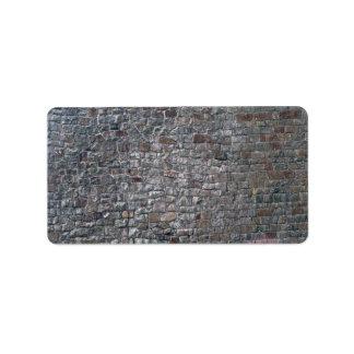 Ladrillo mezclado y pared de piedra etiquetas de dirección