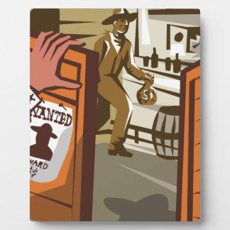 Ladrón del vaquero que roba el poster del salón placas de plastico