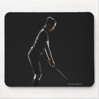 Lady golfer who sets up driver of golf having it mouse pad