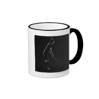 Lady golfer who sets up driver of golf having it ringer coffee mug