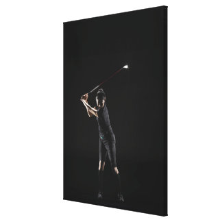 Lady golfer who swings driver canvas print