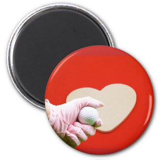 Lady golfer with holding ball with heart magnet
