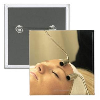 Lady having face massage button