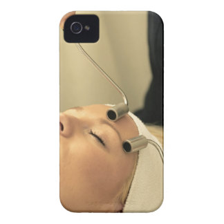 Lady having face massage iPhone 4 case