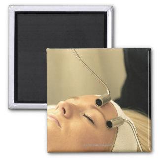 Lady having face massage magnet
