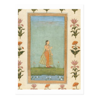 Lady holding a flower, standing by a lily pond, fr postcard