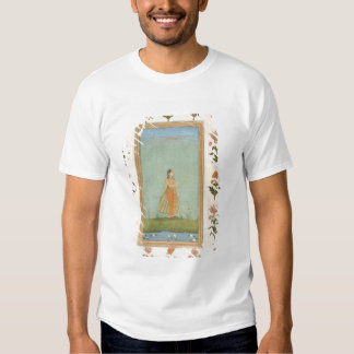 Lady holding a flower, standing by a lily pond, fr tee shirts