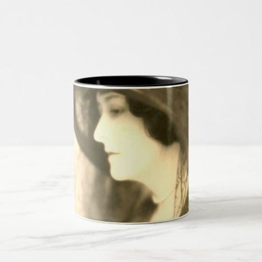 lady in black hat enlarged mug