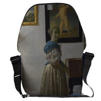 Lady Standing at a Virginal by Johannes Vermeer Messenger Bag