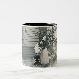 lady with bonnet putting child on seat Two-Tone coffee mug