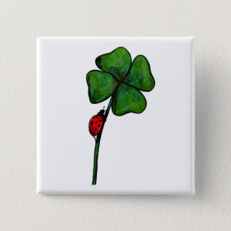 ladybird climbing up a four leaf clover button