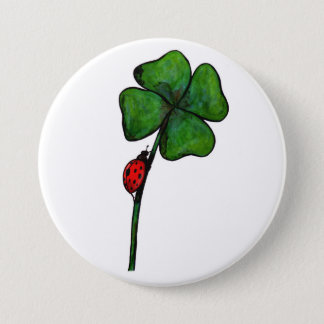 ladybird climbing up a four leaf clover pinback button