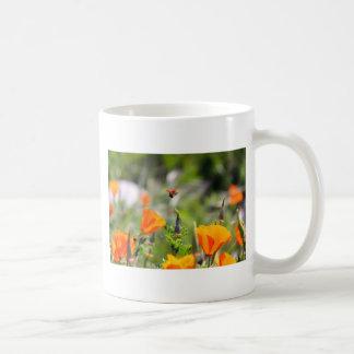 Ladybug flying off flower mug
