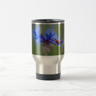 Ladybug on a blue cornflower travel mug