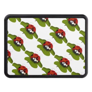 Ladybug on a green leaf tow hitch cover