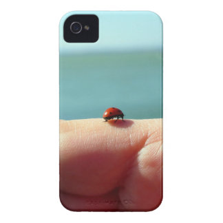 Ladybug on a woman hand in front of the lake iPhone 4 Case-Mate case