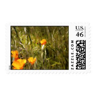 Ladybug reaching for flower postage stamp