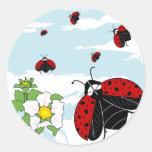 ladybugs in flight round sticker