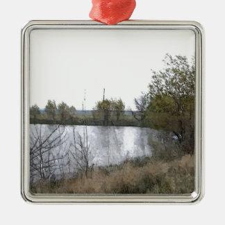 Lago watercolor con los árboles y las ramitas adorno navideño cuadrado de metal