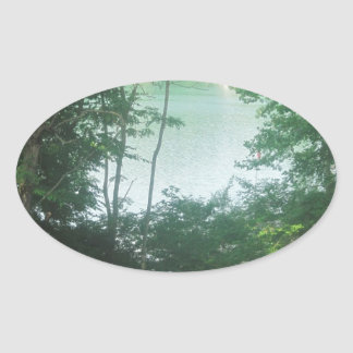 Lake Framed by Trees Oval Sticker