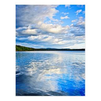 Lake reflecting sky postcard